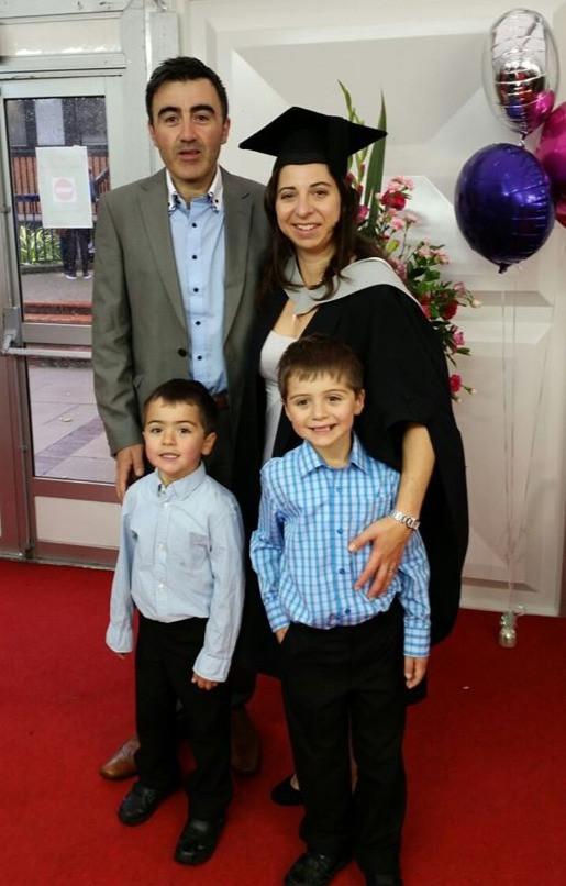 Talia and her family at her graduation