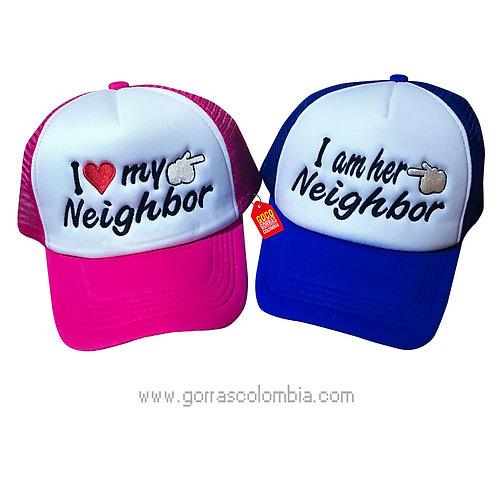 gorras azul y fucsia frente blanco para pareja neighbor