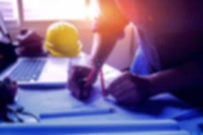 Architect working on blueprint_edited_edited_edited_edited.jpg