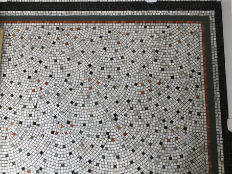 Mosaic repair and conservation.