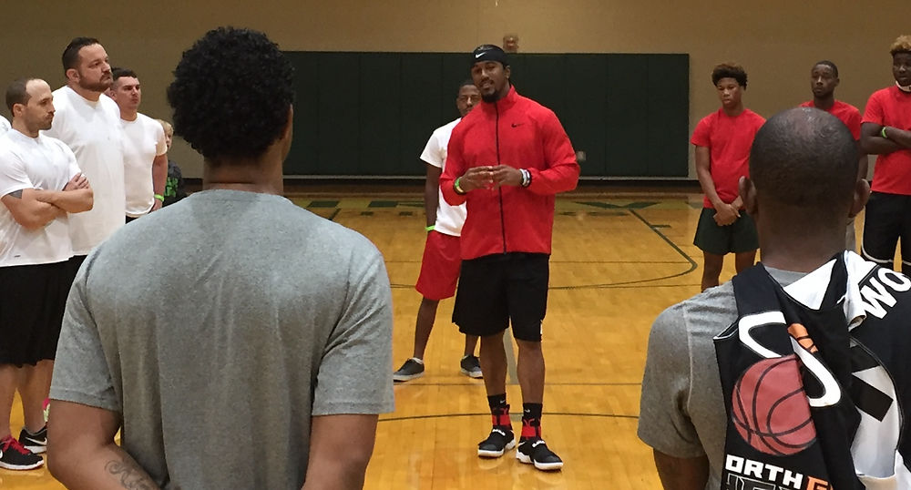 Vic Beasley, Jr. speaking to group at FCA tourney