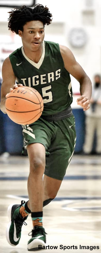 Tigers defeat Woodland to advance; Adairsville girls fall in overtime