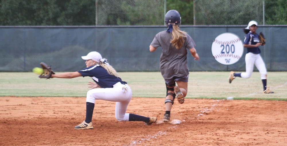 Lady Cats' graduate, Kylie Knox, beats out a throw at first.