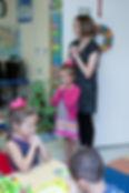 Teacher and children praying at Oak Grove Preschool & Kindergarten in Chesapeake, VA 23320