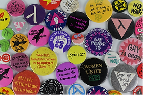 An array of colourful circular pin badges
