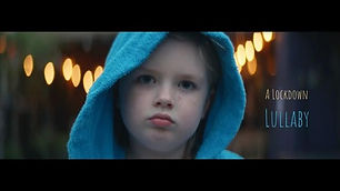 A picture of a kid with a blue hood on