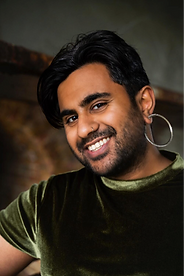 Headshot of a light brown person smiling.
