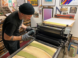 A man working with textiles