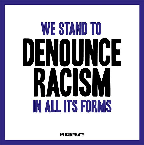 "A poster saying ""We stand to denounce racism in all it's forms"""