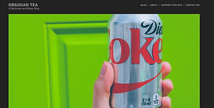 a silver can of diet coke with a green background