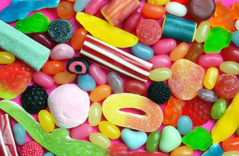 a pile of pick and mix sweets in various colours