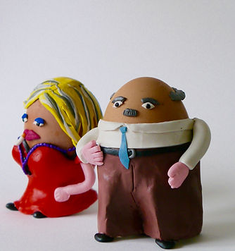 two eggs dressed up as people stand together. one in a suit and the other in a dress