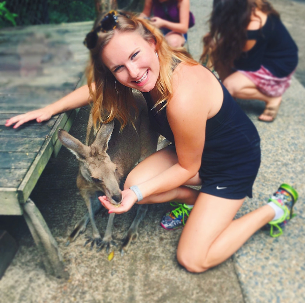 Ellie with a kangaroo in Australia