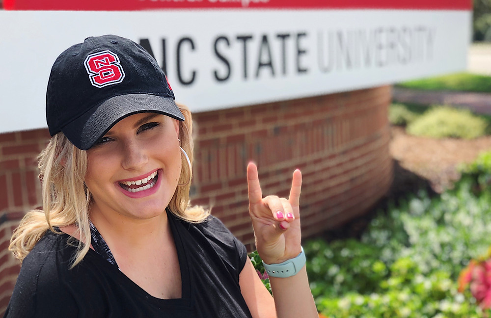 Ellie in NC State hat