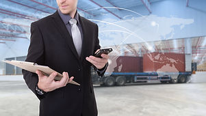 Manager checking plan  at warehouse for Logistic Import Export background (Elements of this image fu