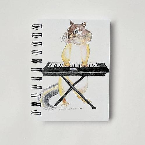 Chipmunk with keyboard notebook