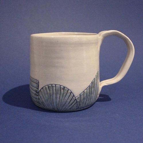 Incised mug with ice blue and blue star glazes