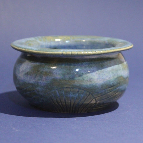 Incised bowl or planter with bright blue glaze
