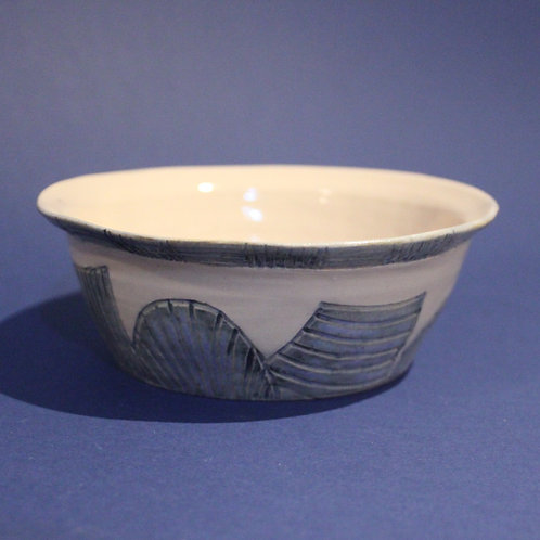 Incised bowl with ice blue and blue star glazes
