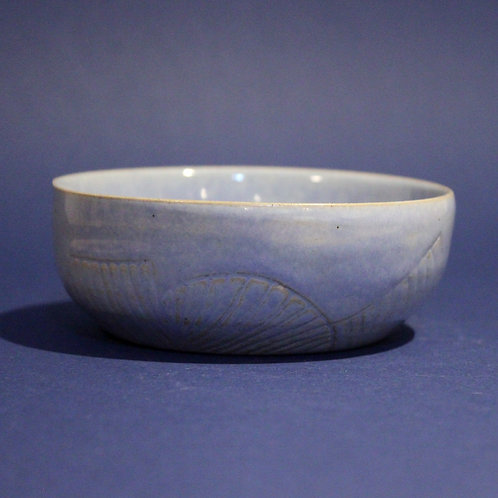Incised bowl with ice blue glaze