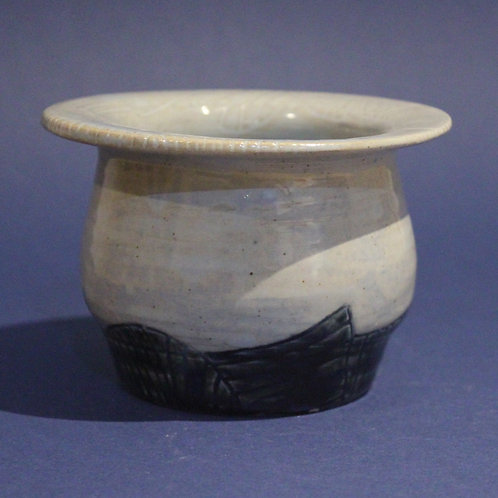 Incised planter with ice blue and star blue glazes
