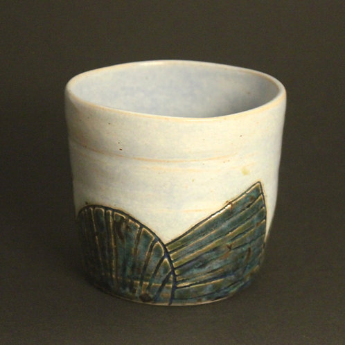 Incised tumbler with ice blue and moonlight glaze