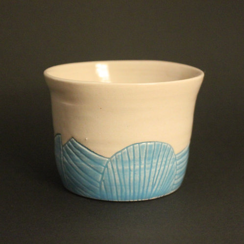 Incised cup/planter with light blue glaze