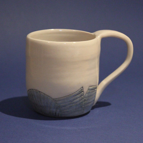 Incised mug with ice blue and blue star glaze