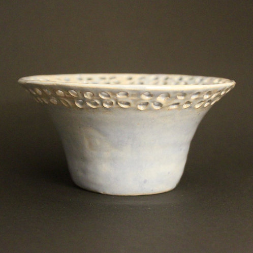 Pierced repeated pattern bowl with ice blue glaze