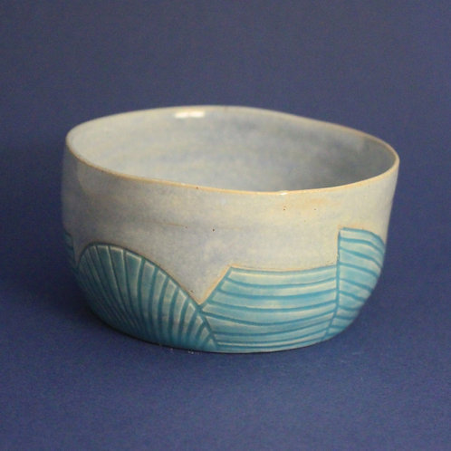 Incised bowl with ice blue and turquoise glazes