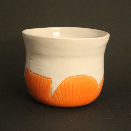 Incised cup/planter with orange glaze
