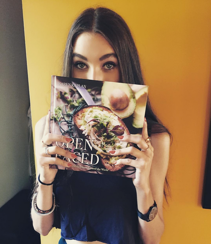 "My daughter, Clara, holding my newly launched Cookbook ""Open Faced: Single-Slice Sandwiches fro"