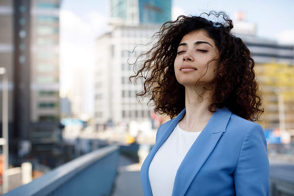 Woman In Suit At Peace In City.jpg