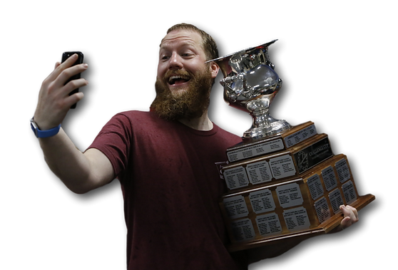 Adult hockey player selfie with the trophy