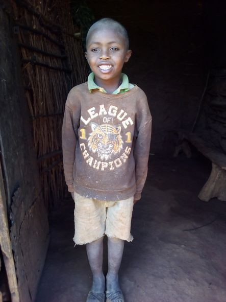 Bariki, 7 years old, is in standard 1 in one of the government primary schools in his village. He is the second oldest of 3 children in his family.