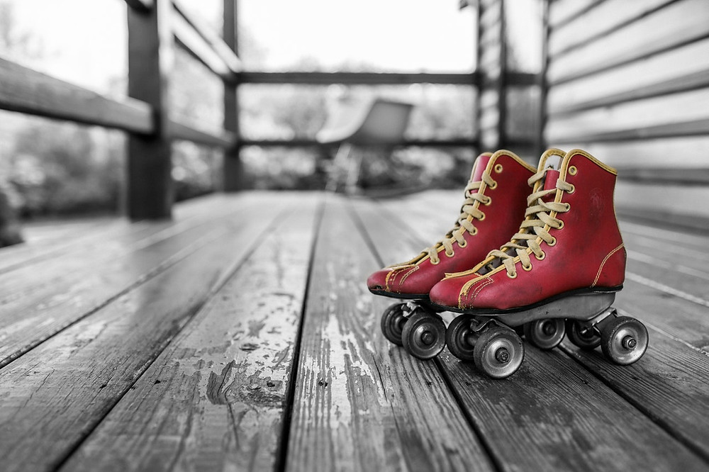 vintage red roller skates on a front porch