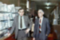 Old photo of the dad and grandfather of Lynn Swords, standing in Tickner's Mens Wear