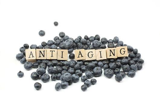 Anti Aging wooden blocks on blue berries