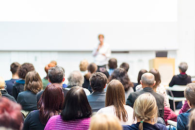 publiek op symposium