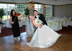 Violin and Dancing couple smiling