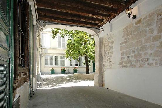 Location Appartement Transparent Marais : la cour intérieure du 94 rue du Temple à Paris