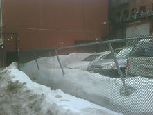 commercial fence repair, parking lot fence repair, snow damage fence repair, fence restoration, chain link fence repair