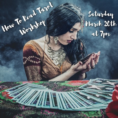 """A mystical looking woman with long dark hair swept over one shoulder looks down at tarot cards held in her two hands. Before her on a table with a colorful tablecloth are large tarot cards that are fanned out. The background is a smoky gray and the image reads """"How To Read Tarot Workshop Saturday March 20th at 7 pm"""""""