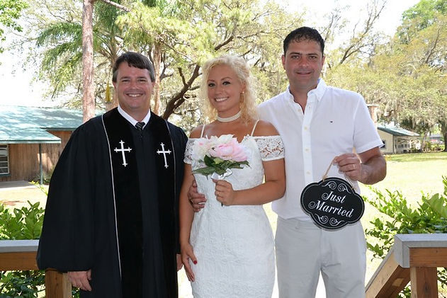 Rev. Paul With Bride And Groom