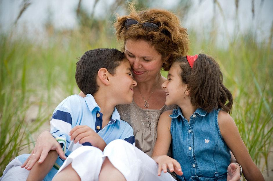 o-mom-and-kids-on-beach 72 dpi.jpg