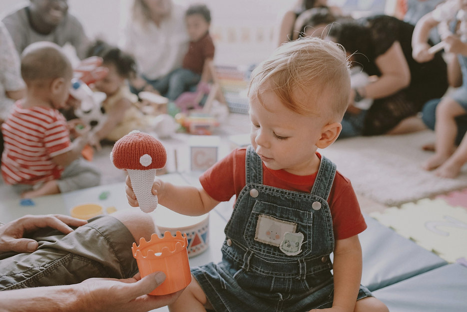 Little boy playing with toys with other kids