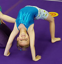 Gymnast Doing a Bridge at a Gymnastics Summer Camp