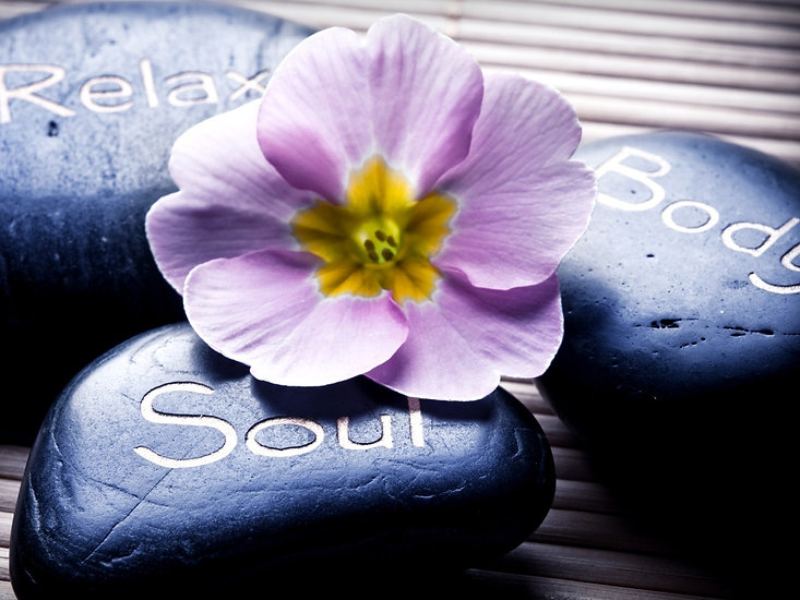 three massage stones - relax, body, soul