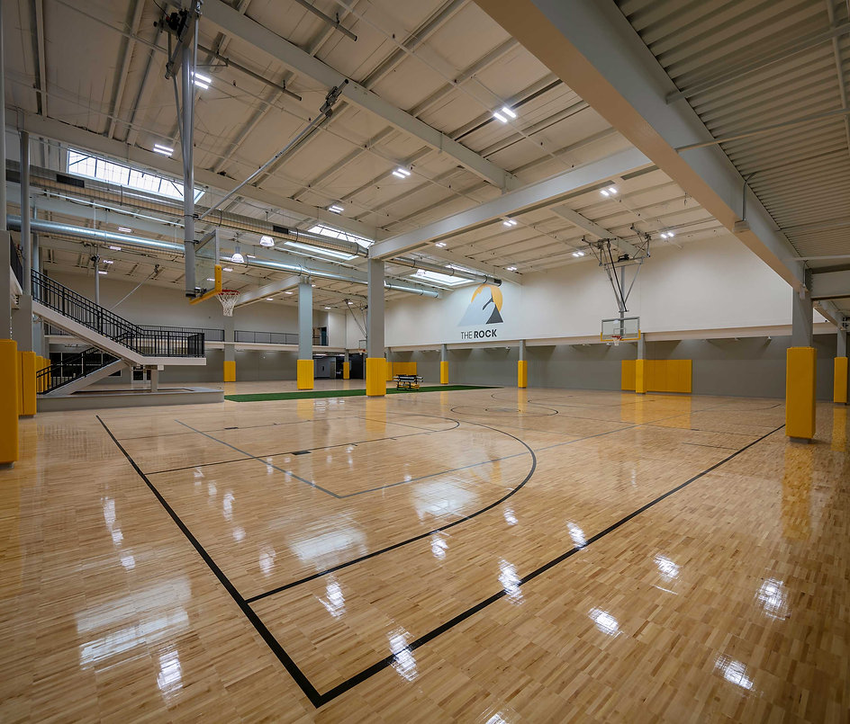 Wolverine Worldwide HQ located in Rockford, Michigan. Wood gymnasium flooring placed by Fosters
