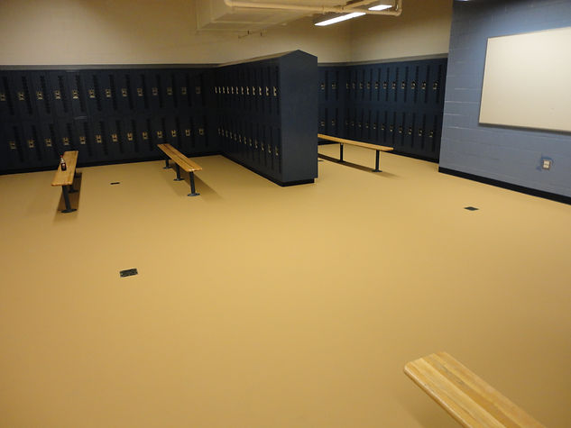 Locker room flooring uses a slip-resistant surface to withstand high traffic placed by Fosters